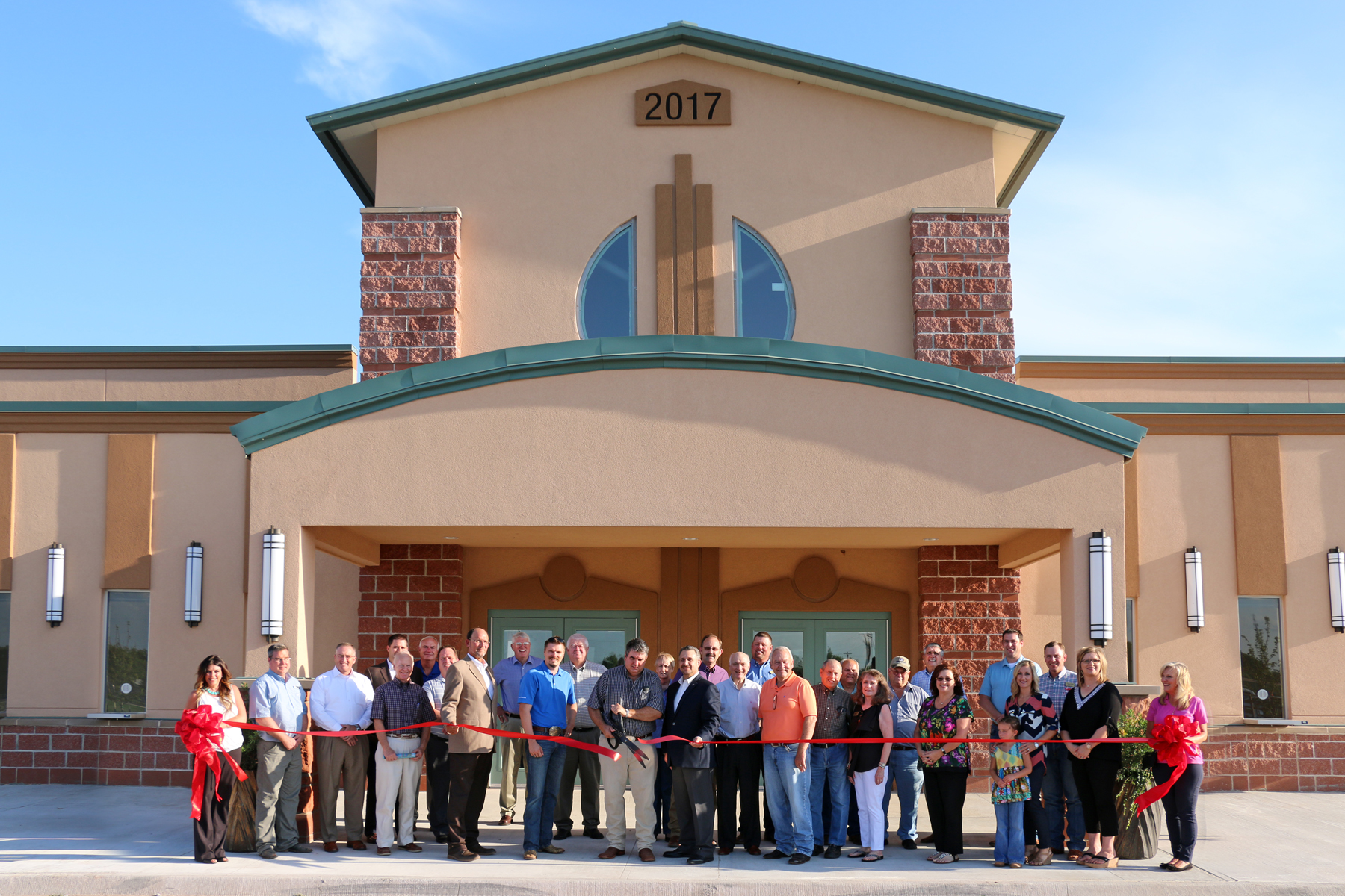 Pictured above: Grady County Fair Board Members, County Commissioners and local Business and Community Leaders cut the ribbon to open the new Indoor Arena.