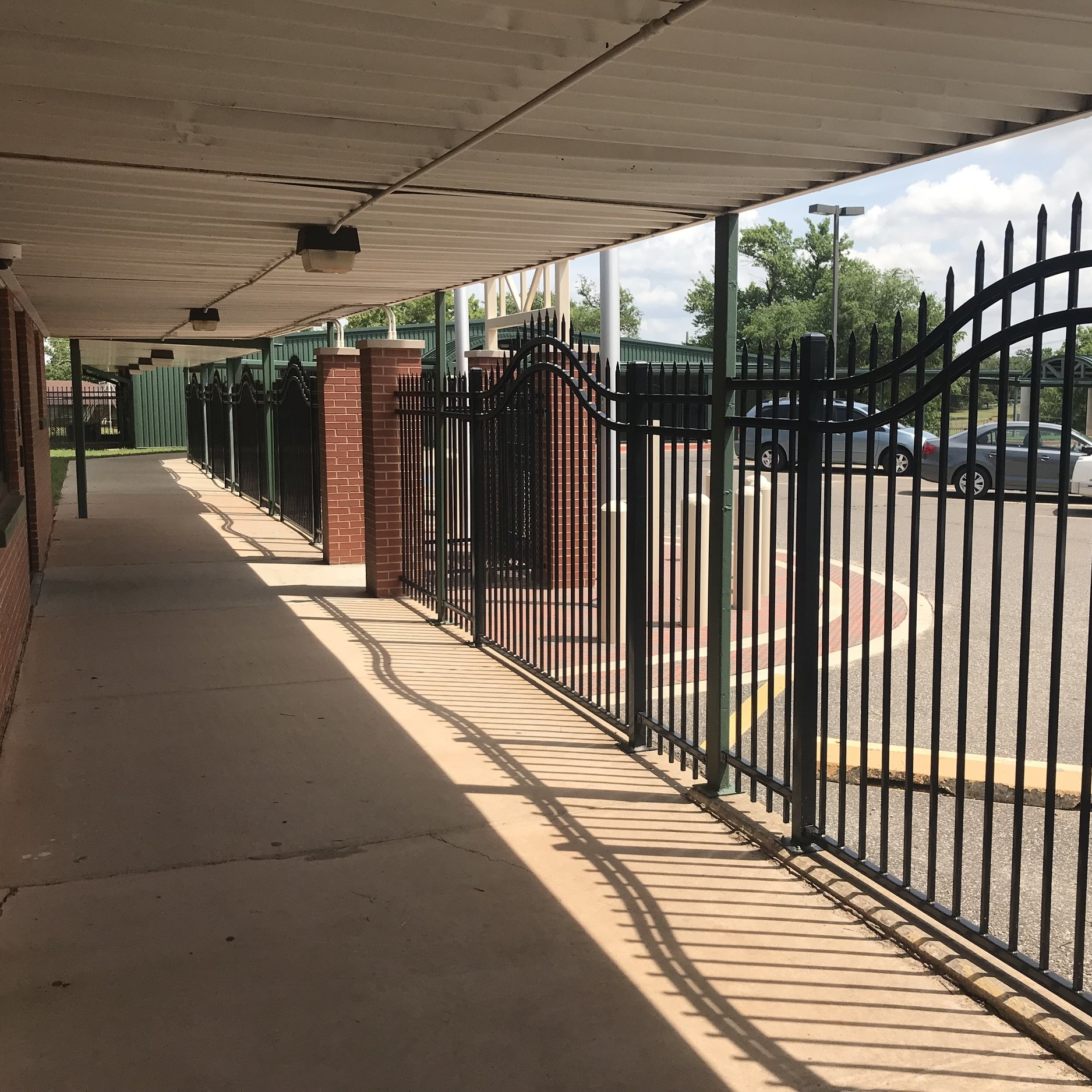 Fencing to secure pathway between buildings.