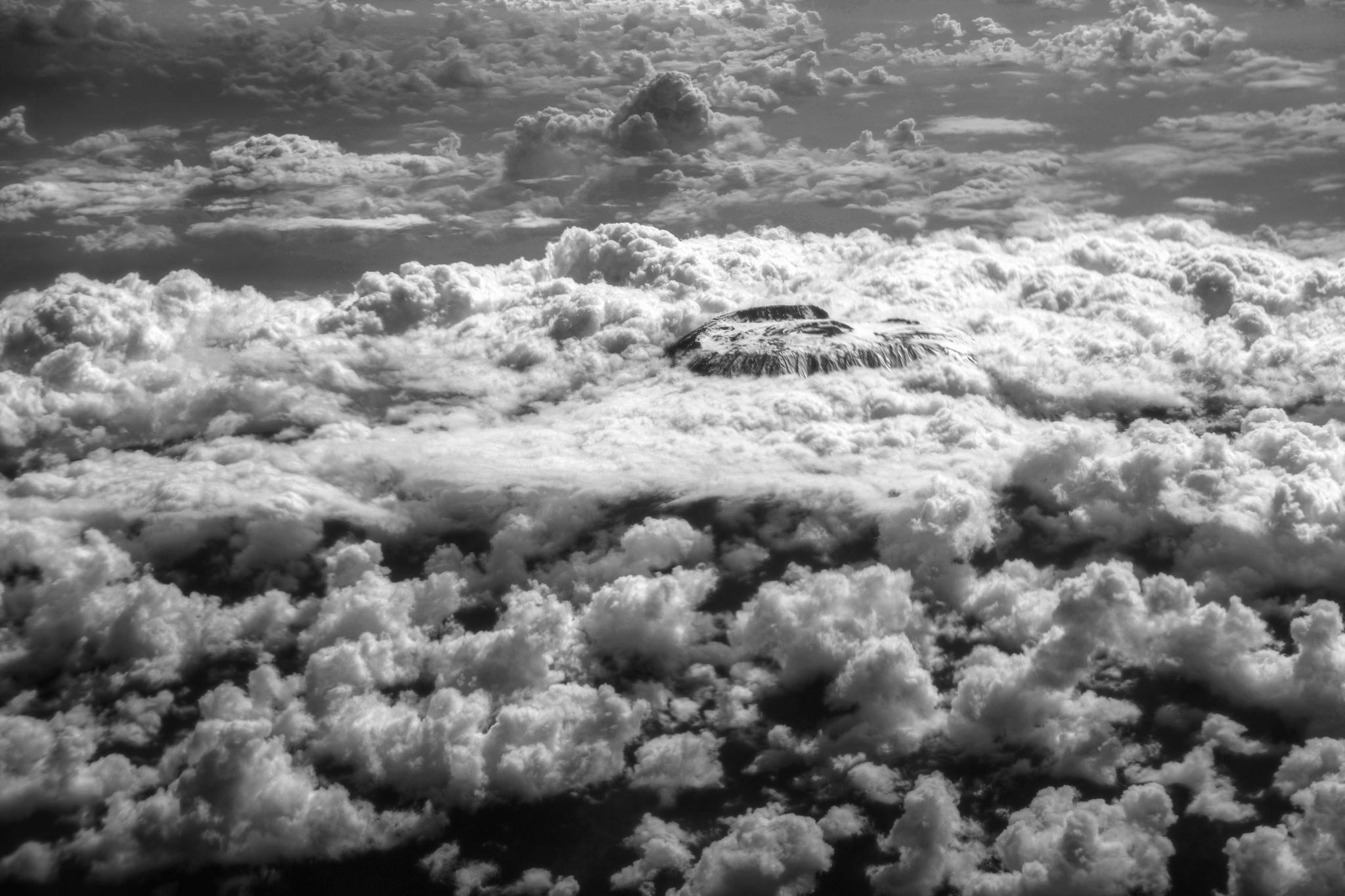Kilimanjaro and Clouds   (2014). Photograph by Mariusz Kluzniak .