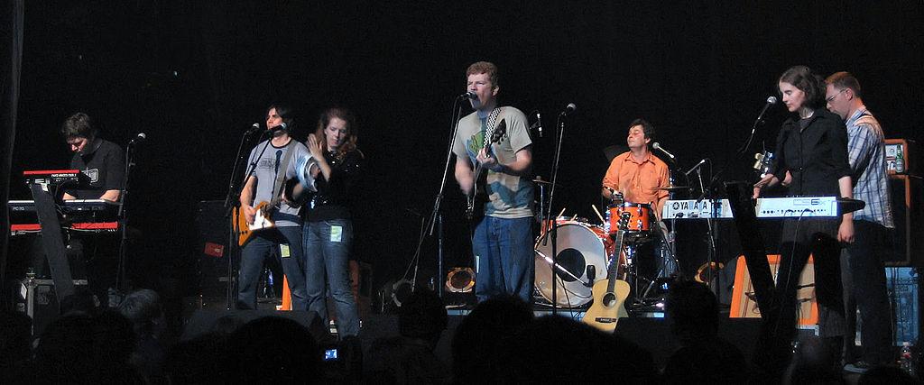 Left to right: Blaine Thurier , Todd Fancey , Neko Case , Carl Newman , Kurt Dahle , Kathryn Calder , John Collins.  Image credit: Simon Law , via Wikimedia Commons.