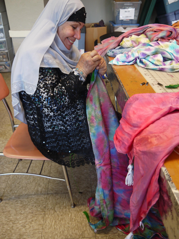 Hlaiwah sewing tassels on