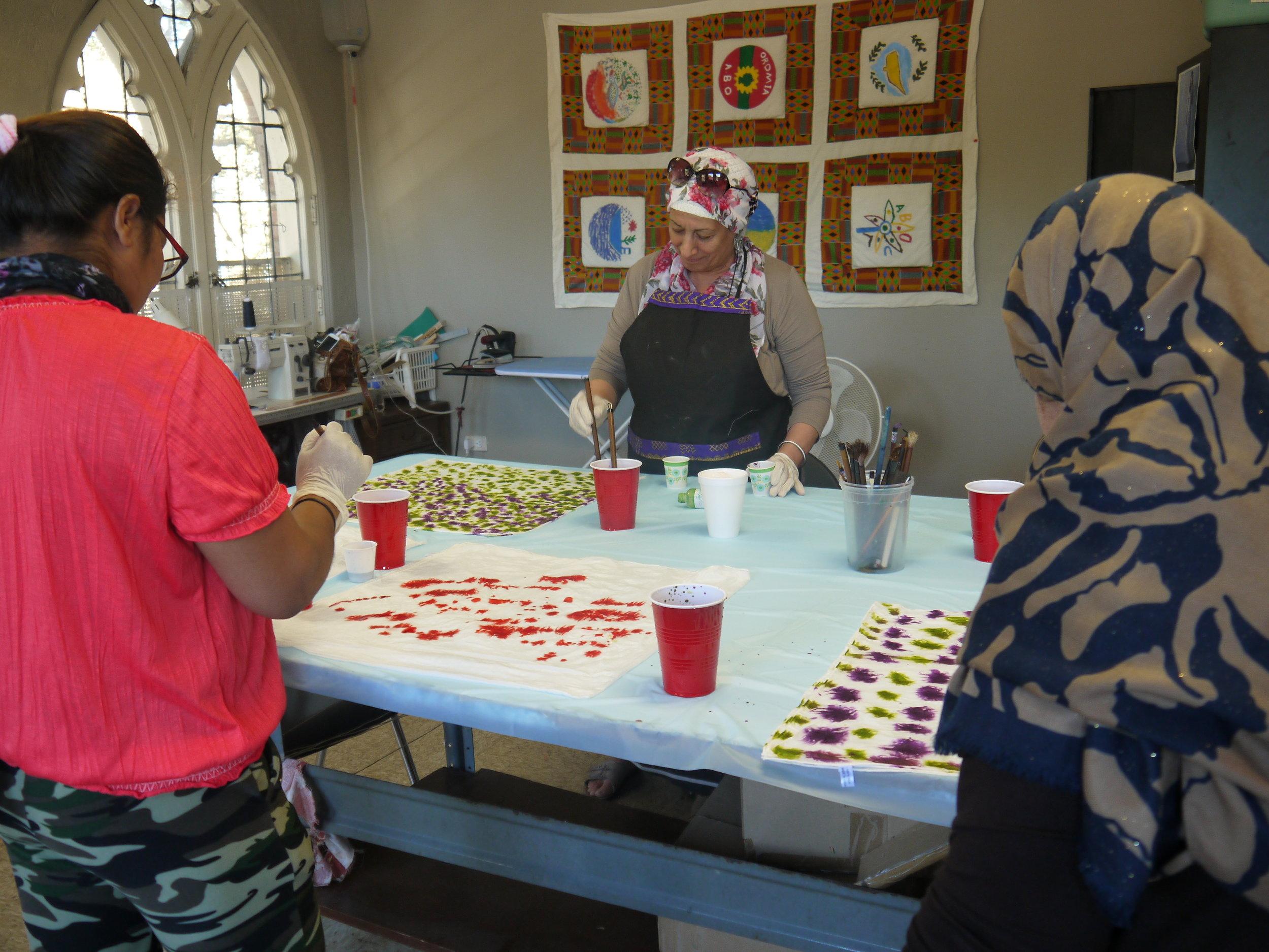 Boj Josi, Batool, and Hlaiwah working on their creations