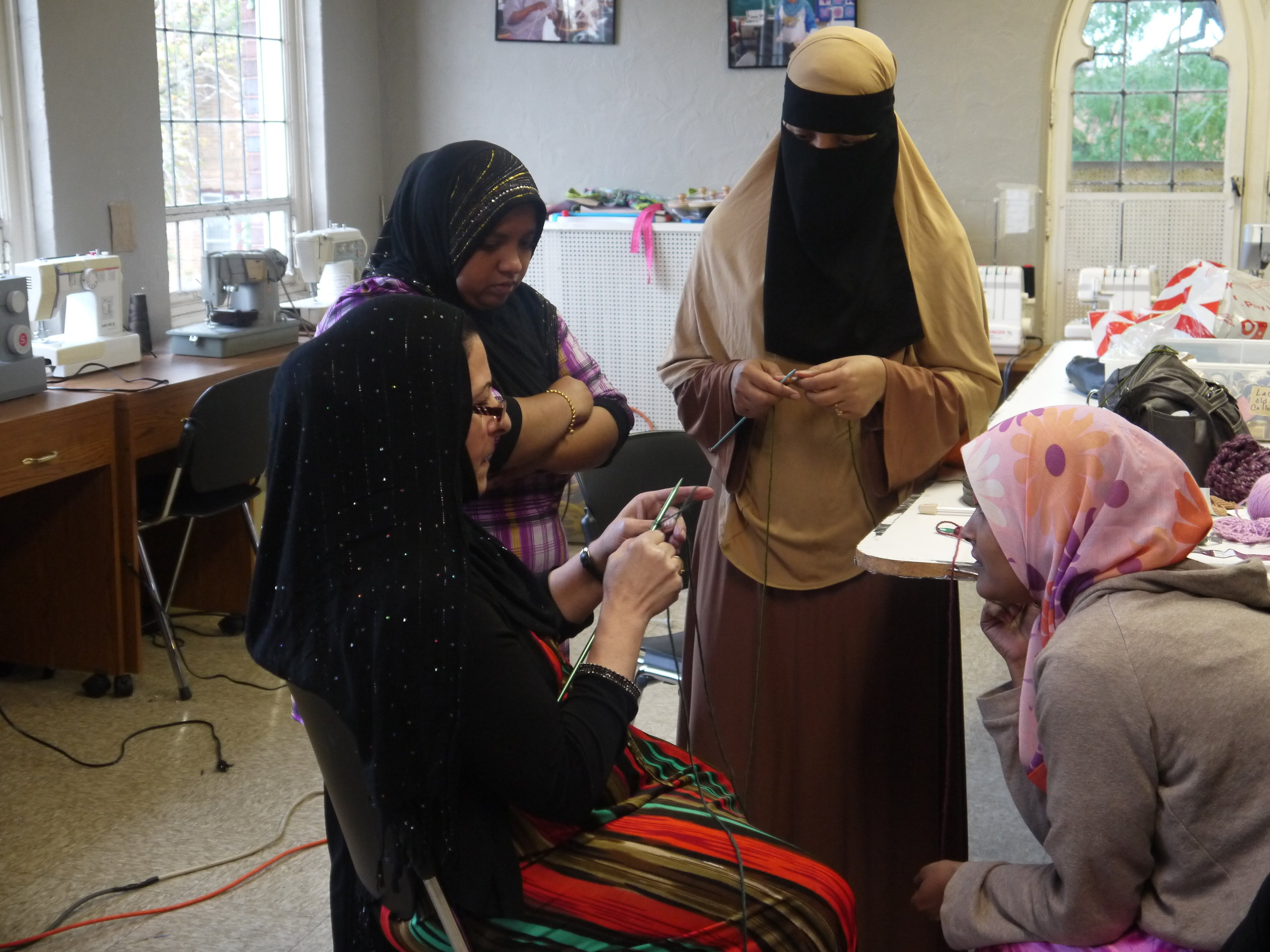 Saleemah sharing her knitting expertise with new artisans from Malaysia.