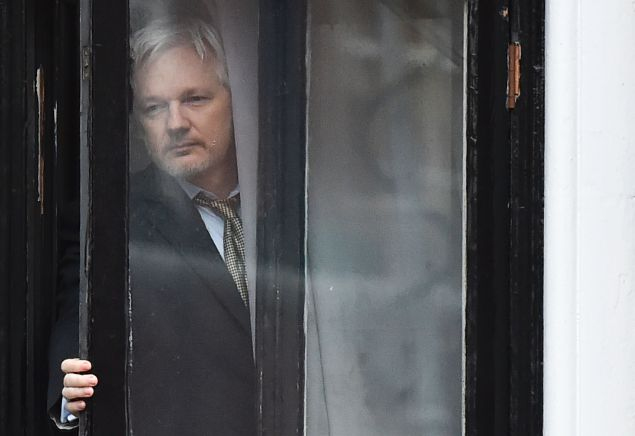 WikiLeaks founder Julian Assange comes out on the balcony of the Ecuadorian embassy to address the media in central London on February 5, 2016. Photo: BEN STANSALL/AFP/Getty Images