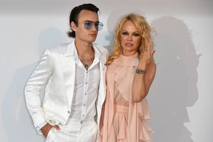 Brandon Thomas Lee and his mother, Pamela Anderson, stop for photos as they arrive last month for amfAR's 26th Cinema Against AIDS gala at the Hotel du Cap-Eden-Roc in Cap d'Antibes in France. (Alberto Pizzoli / AFP / Getty Images)