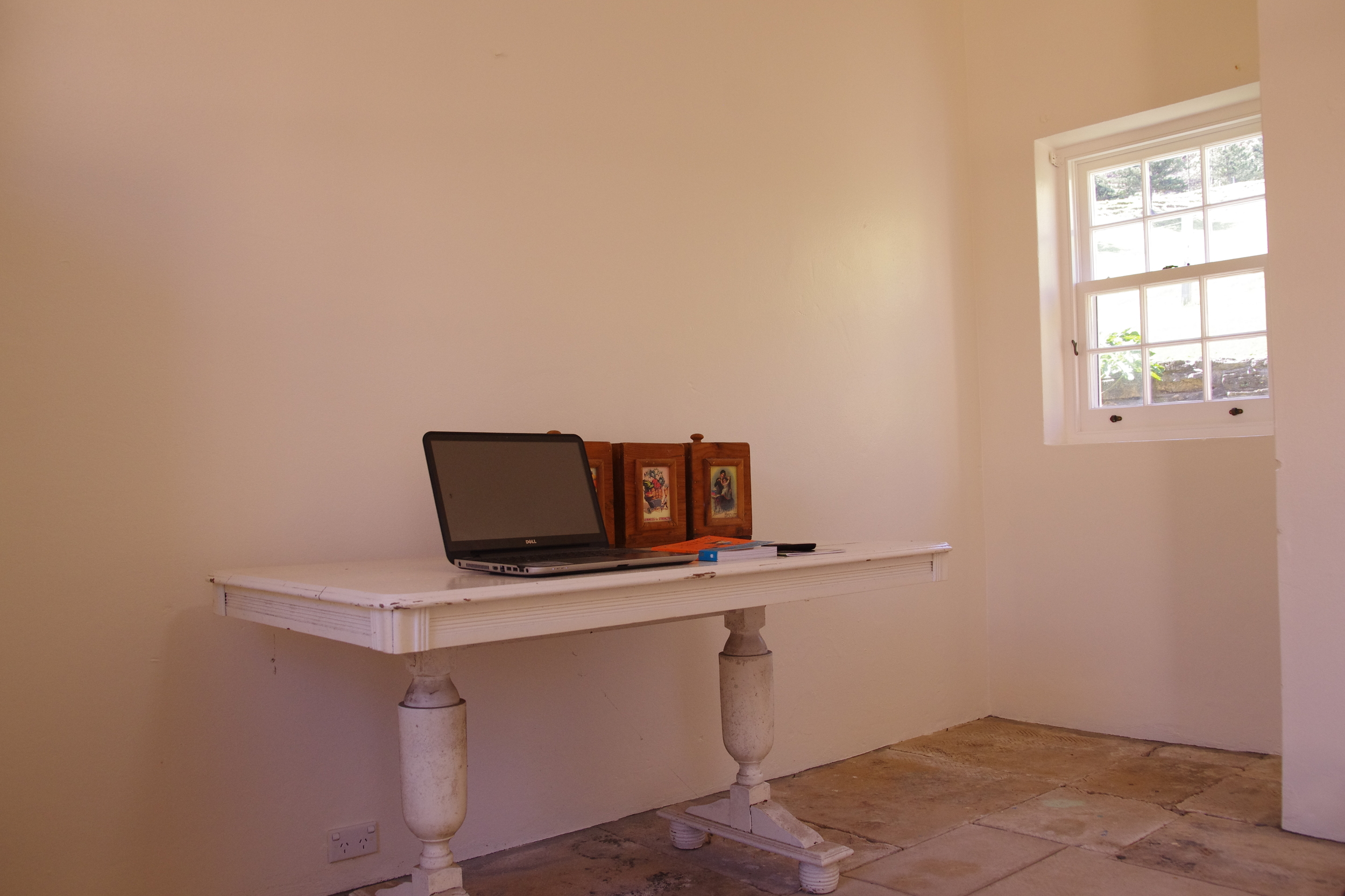 The table (needs a bit more a clean), and awaits a chair.