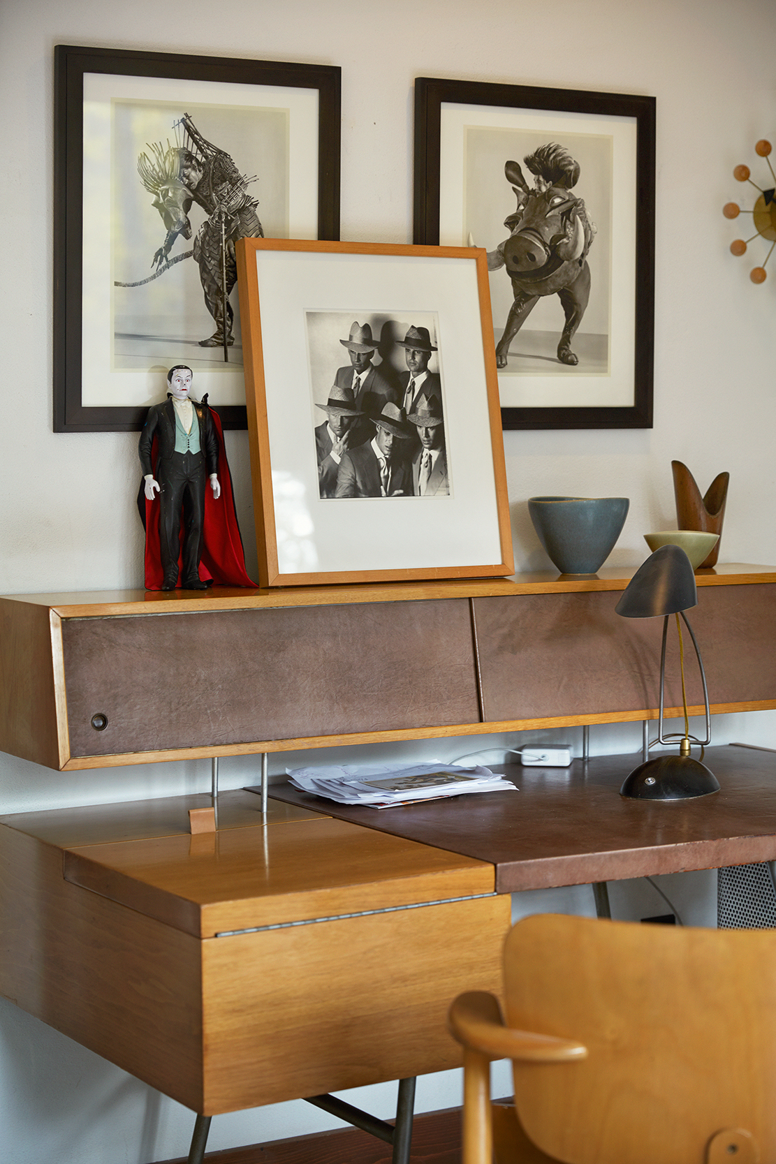 Their photography with desk by George Nelson for Herman Miller. Pottery by Gunnar Nylund.