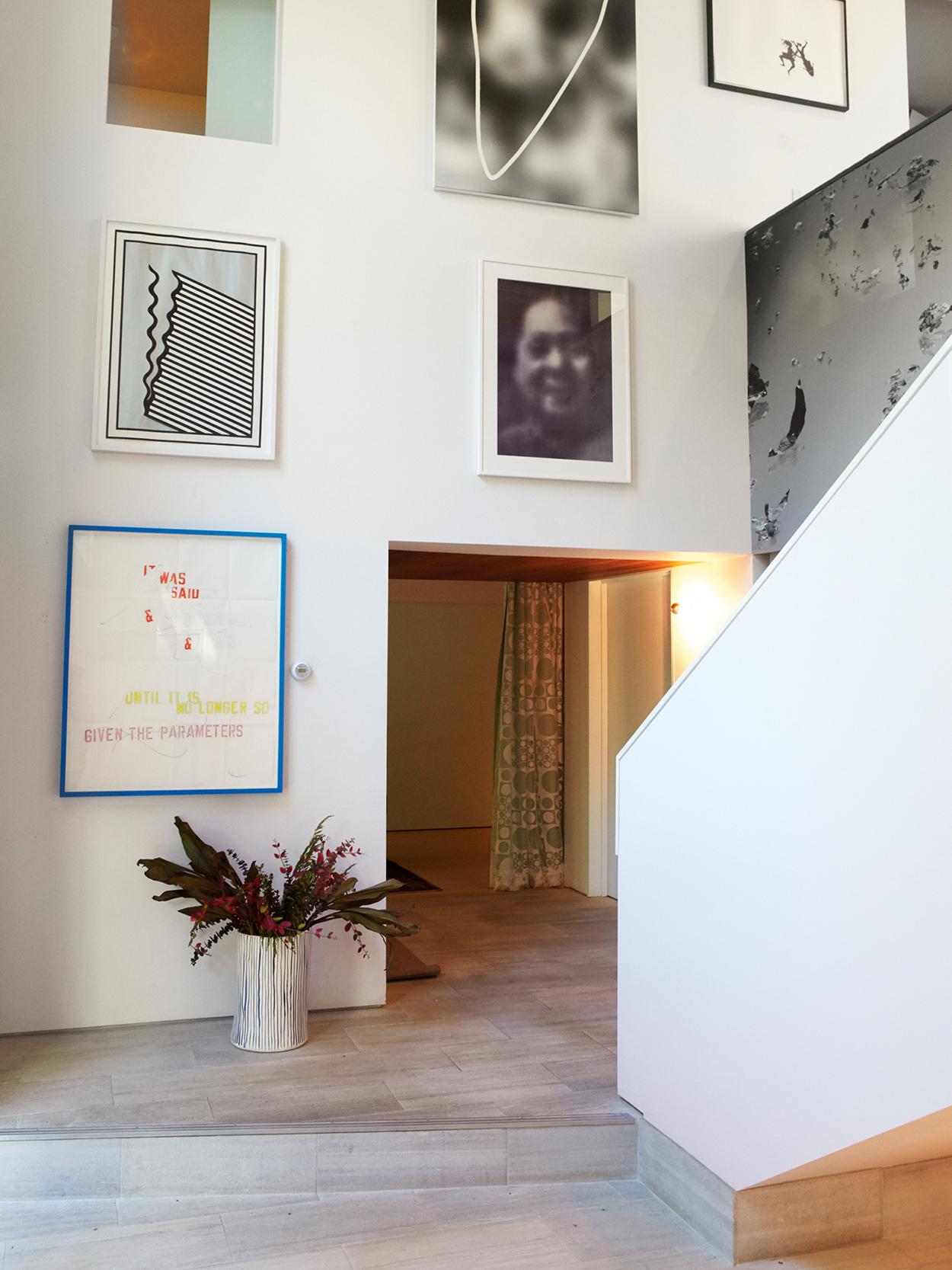 Hallway art by Nicholas Krushenick, Laurence Weiner and Gerhard Richter.