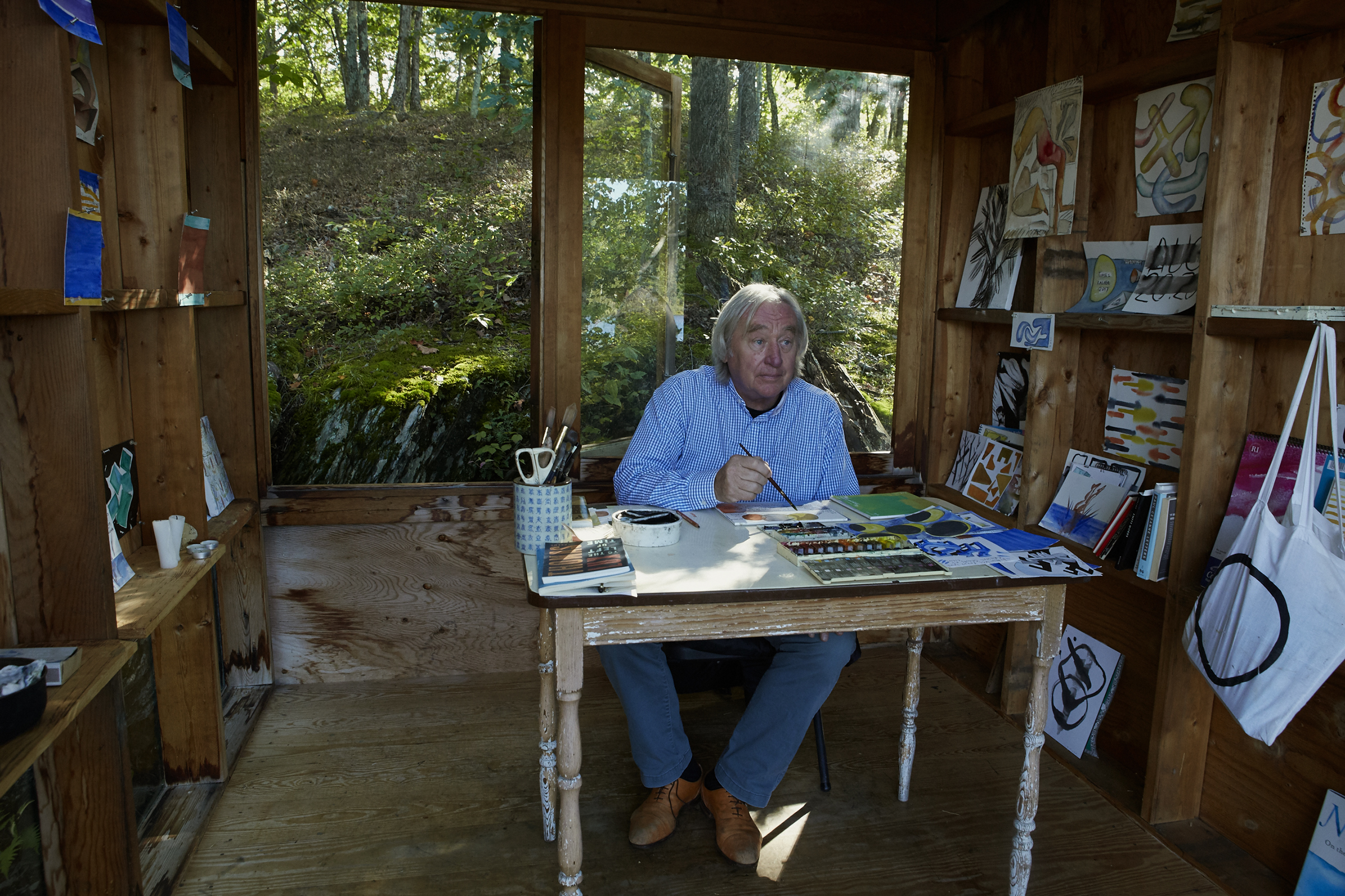 Holl at work in his watercolor hut by the lake.