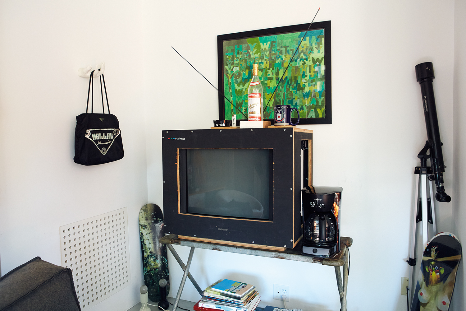 Left to Right:  The Sweat Shop  bag, by Kader Attia,  TV Party , '14 by Tom Sacks.