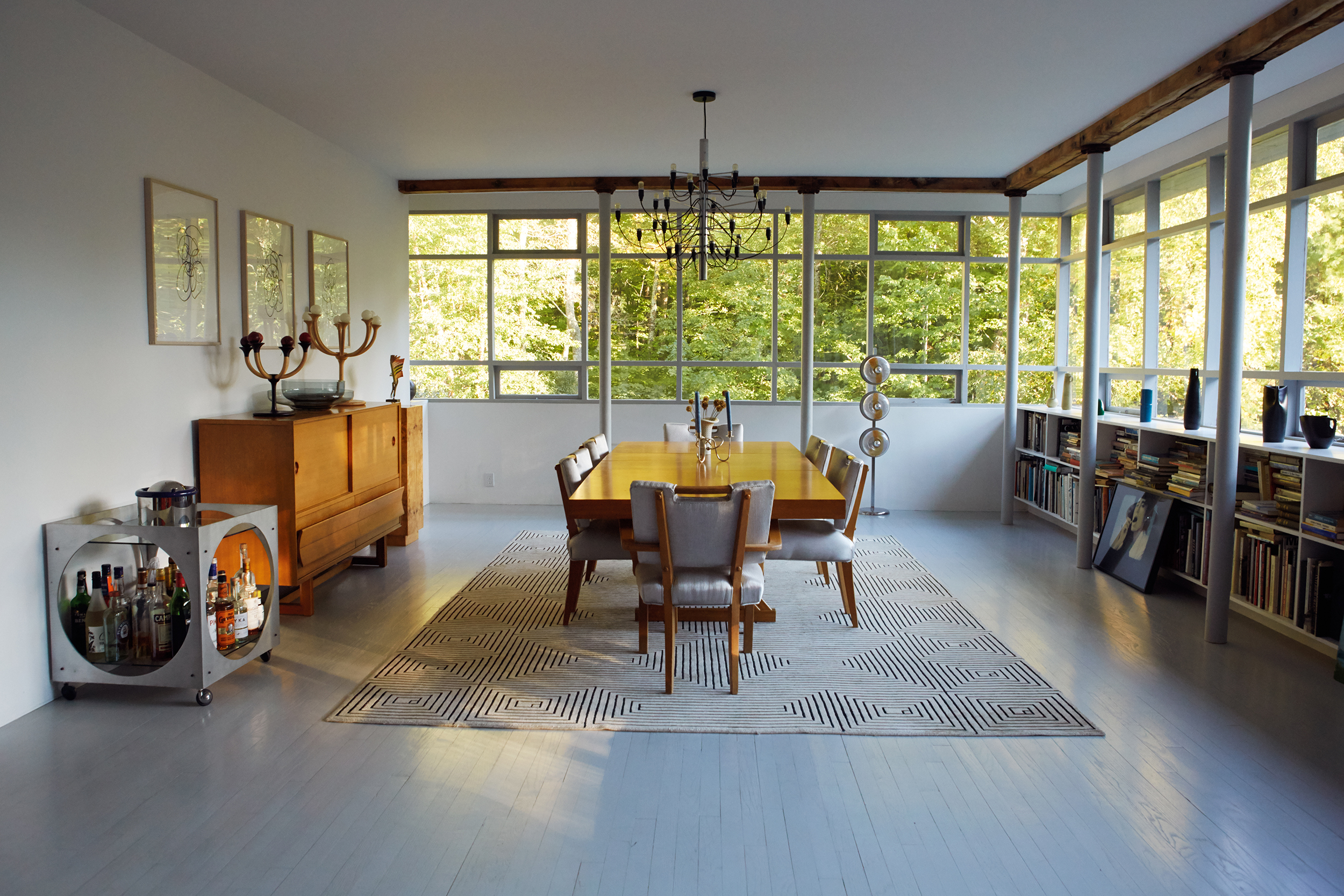 Dining table, chairs and credenza by Paul Lazsló. Carpet from the estate of Geoffrey Beene.