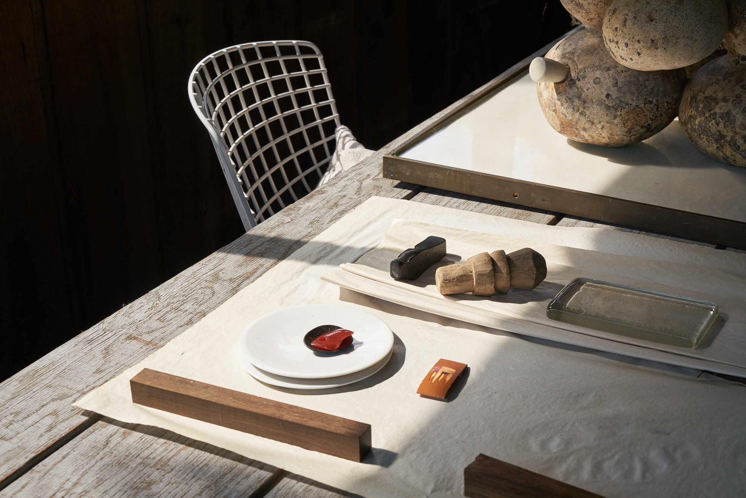 Studio table with components for assemblages.