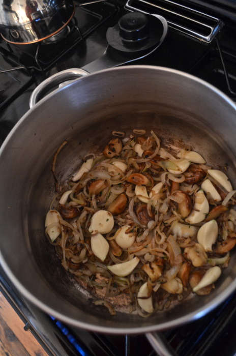 Over medium-high heat, add a little olive o, the sliced onion, shallots, peeled garlic, roasted garlic…
