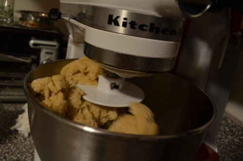 """This is how we """"dough it.""""   Pour the melted milk butter into the bowl with all the dry ingredients and then beat in the eggs. Knead for 5 or so minutes with a dough hook."""