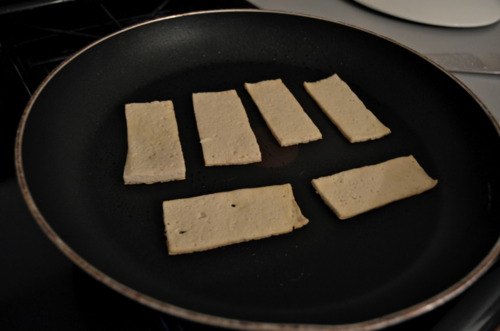 B) All you need to do is heat a pan with some vegetable oil, and then plop 'em down.   Secret: You will get the urge to check on them, touch them, flip them, talk to them, etc.   DON'T. Don't disturb the magic that is cooking tofu.