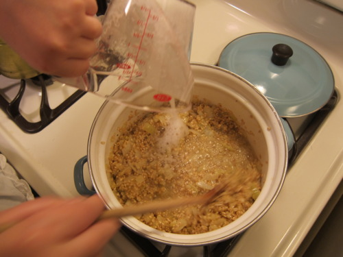 1/2 cup champagne. Stir.stir.stir. 1/2 cup broth. Stir.stir.stir. Rinse and repeat. Rinse and repeat. If you're not stirring, you're doing something wrong. This is what you sign up for when you sign up for risotto.