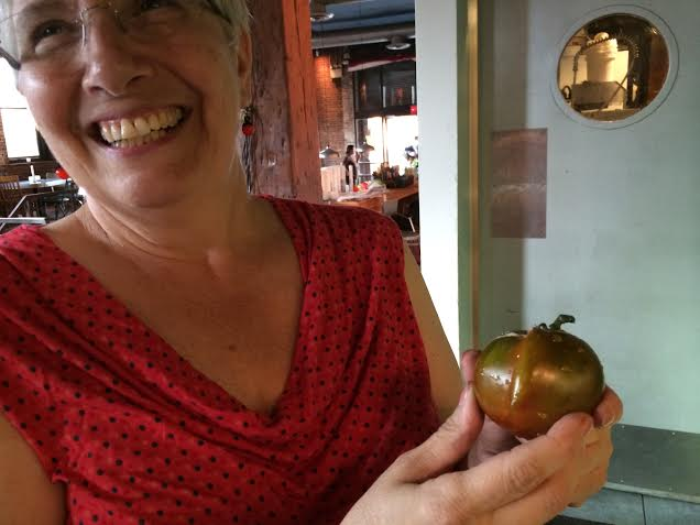 We laugh at the slightly misshapen Brown tomatoes.