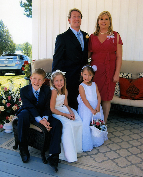 Derek, Ashley, and Morgan with mom and dad at a wedding in Canada 2010