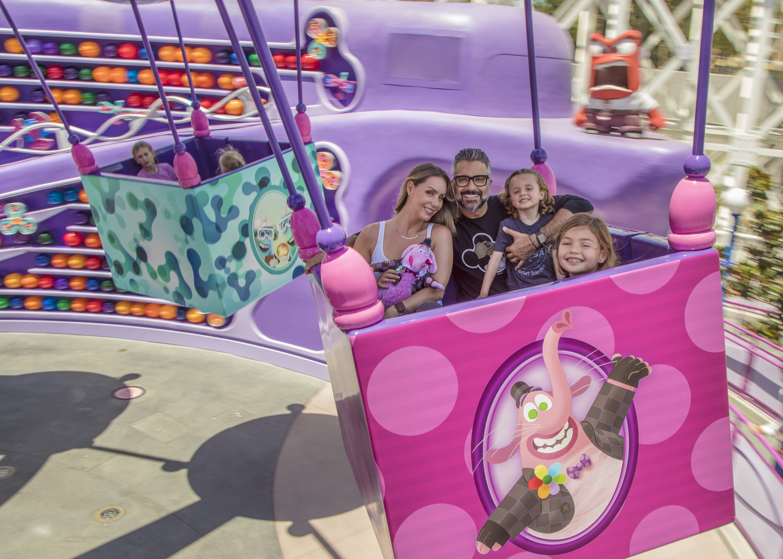 Actor Jaime Camil enjoys a spin on Inside Out Emotional Whirlwind, Pixar Pier's newest attraction, with his wife and children at Disney California Adventure Park - Disneyland Resort - 7/15/19. (Joshua Sudock/Disneyland Resort)