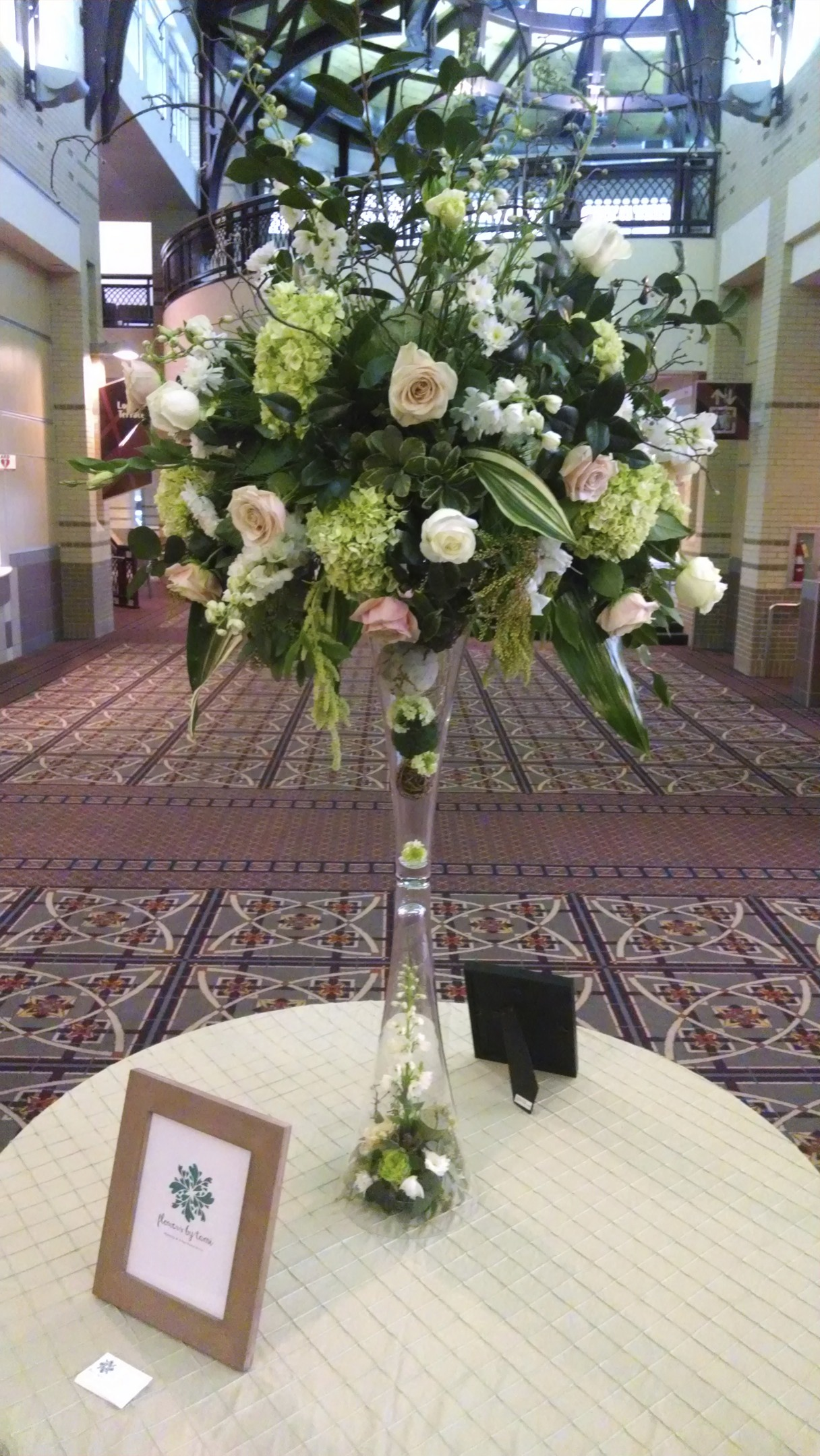 Entrance tabe piece. Sahara Roses, white Delphinium, green Hydrangea and Amaranthus.