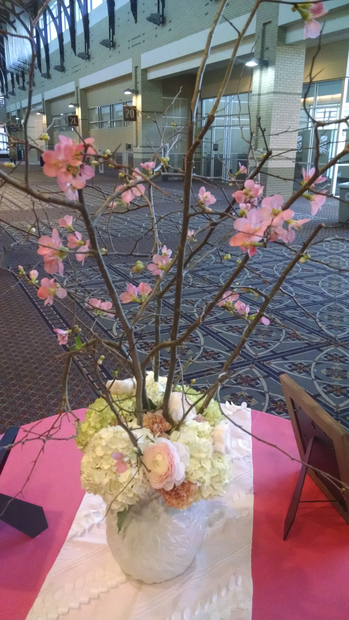 Flowering Quince branches with hydrangea, ranunculus and carnations.