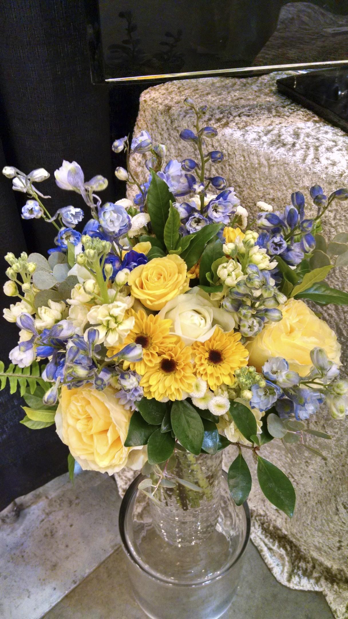 Delphinium, viking daisies, roses, stock, feverfew
