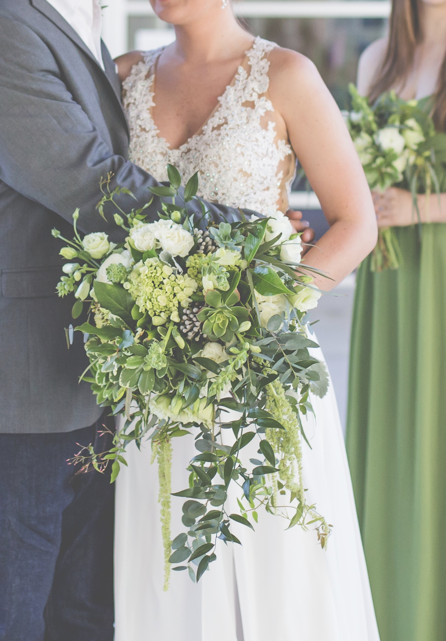 Wild Garden, Draping Greenery Style with Succulents, Amaranthus, Lisianthus and Hydrangea. Photo by New View Photography.  2 on the Roof, Chattanooga TN.