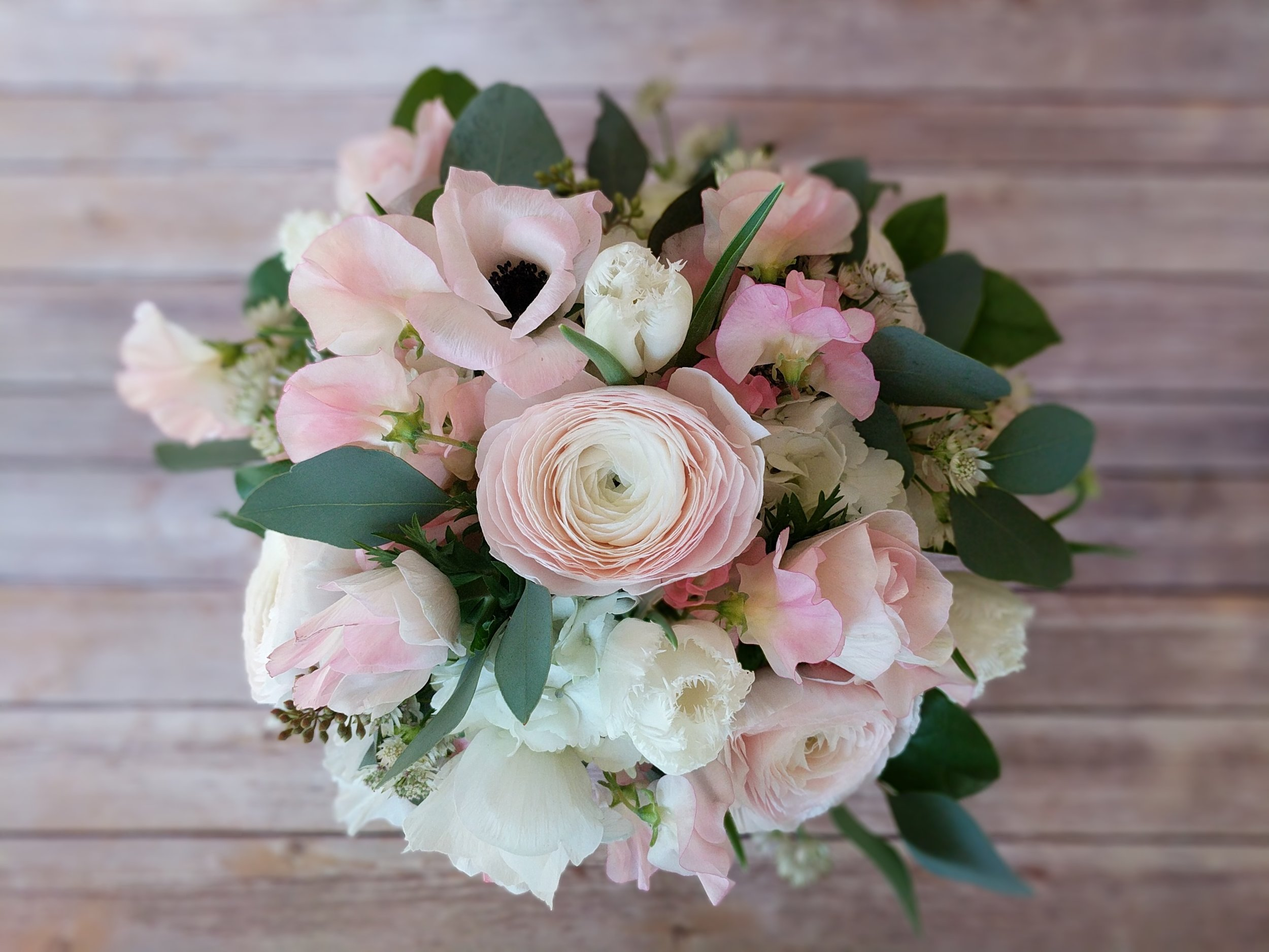 Shades of soft pink with ivory and dusty blue