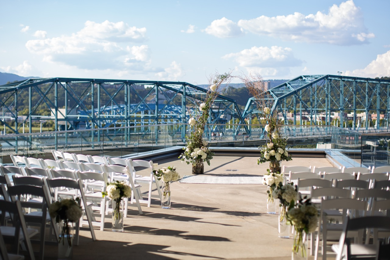 Willow Arch with Hydrangea and greenery aisle markers