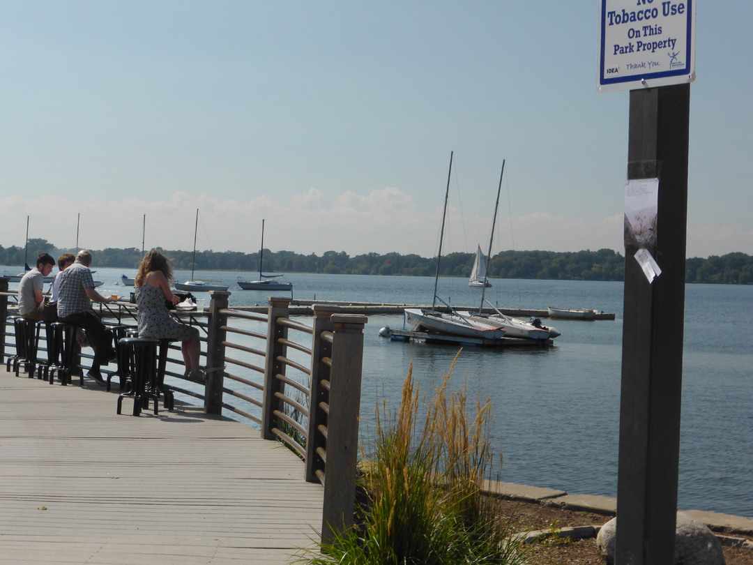 next to Lake Calhoun, which is in the middle of the city, where there is a junction of bikers, pedestrians, and an outdoor eatery.