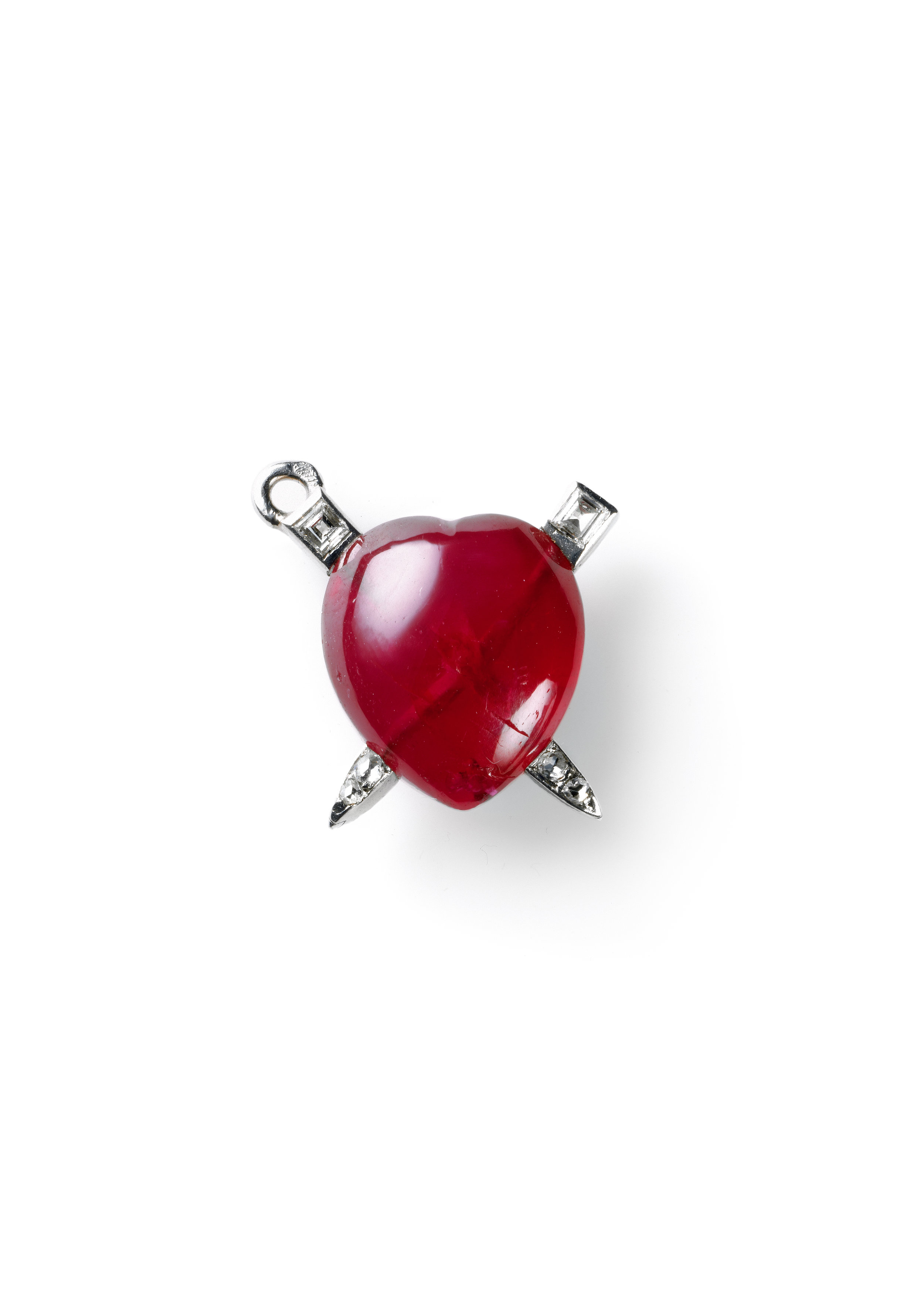 The Cartier Breloque Coeur made in 1929 from a heart-shaped cabochon ruby crossed through by platinum and diamond studs_Photo by Nick Welsh_© Cartier_from_RUBY_published 2017.jpg