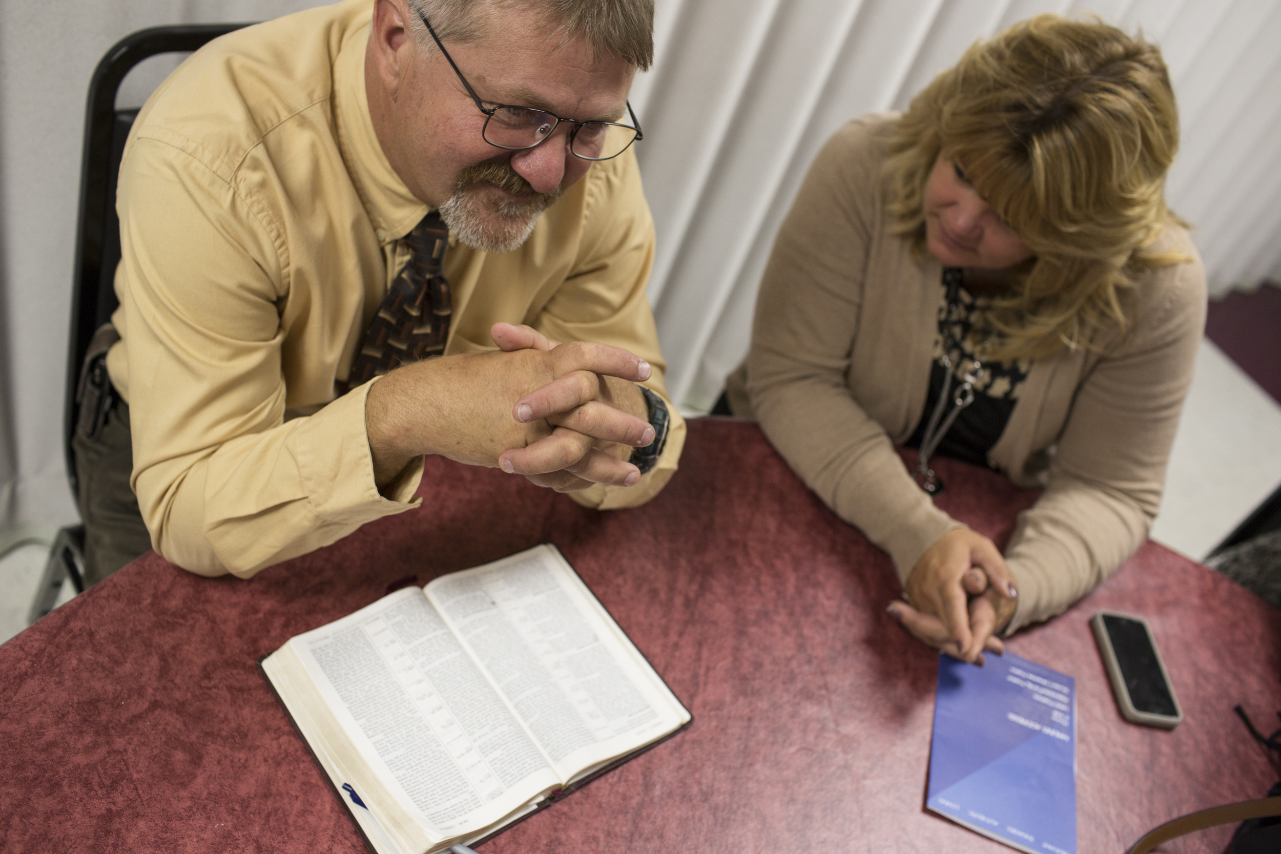 Tracy Groves and his wife Teresa listen during a bible class before a Sunday service at the Assembly of God church in Ellicott City, Maryland.