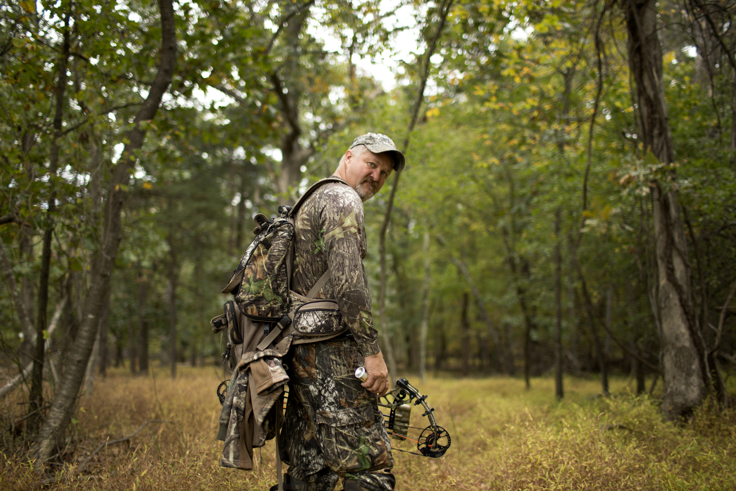 Tracy Groves stands on the edge of a forest on his way to a tree stand during his first hunt of the 2015 Maryland deer season.