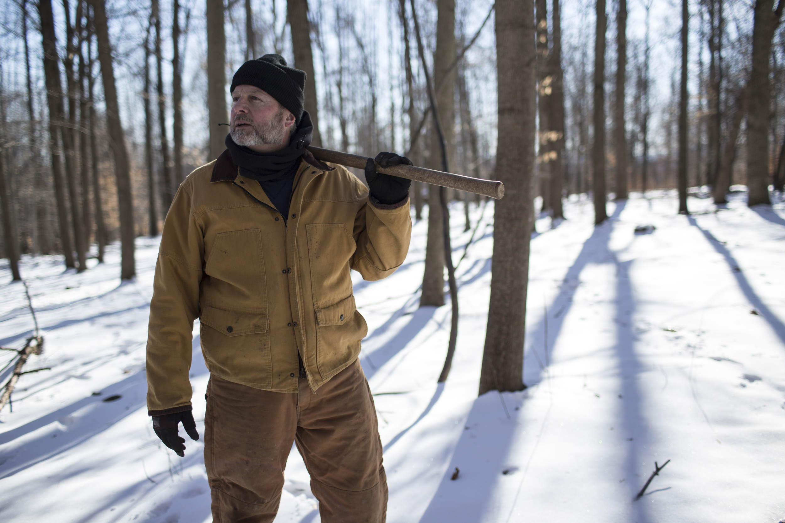 Barry Howe waits during a tree planting session to re-vitilize a hunting area, near Indian Springs, Maryland.