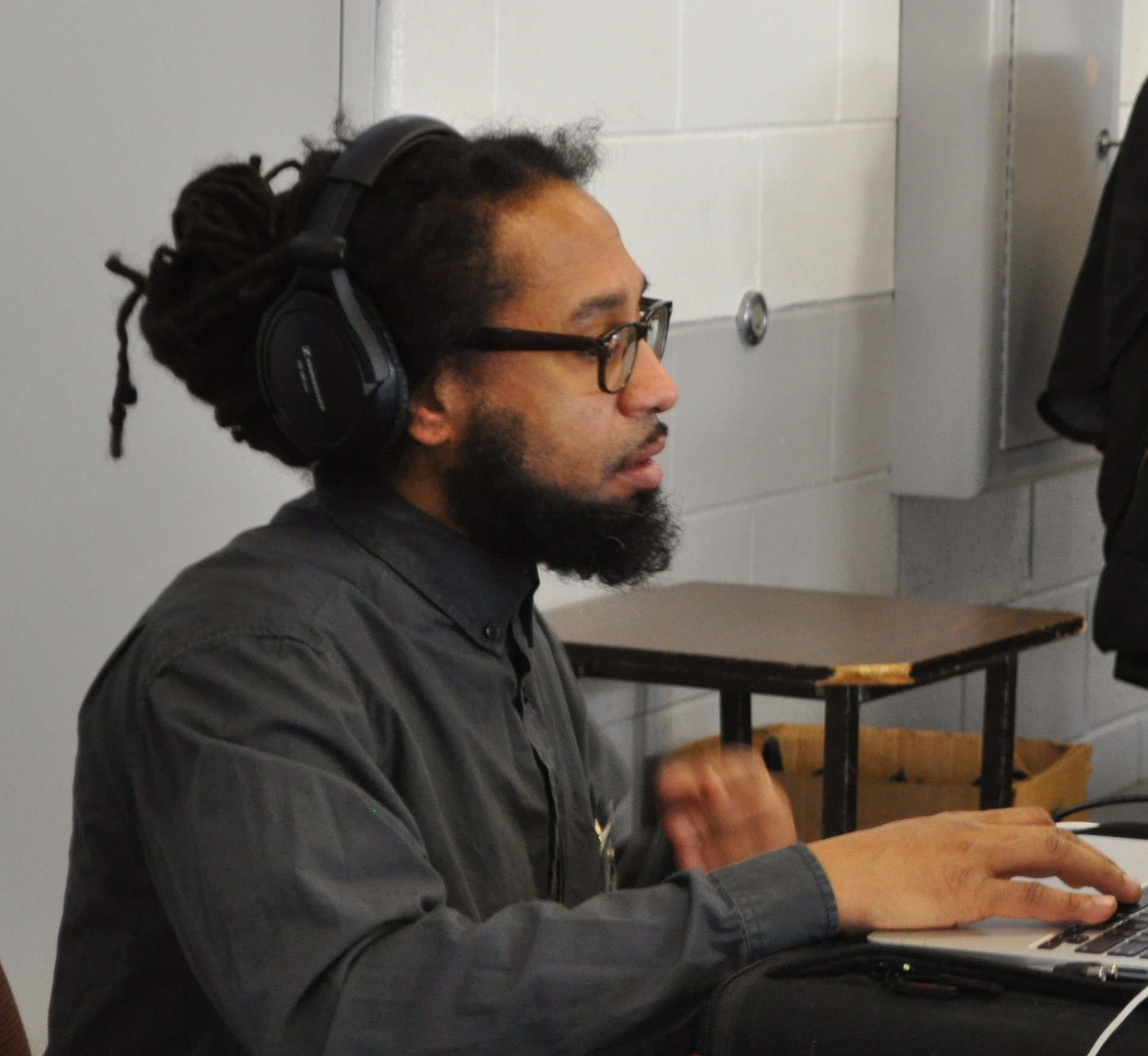 Candid shot of Doc Israel working on the music during a recording session