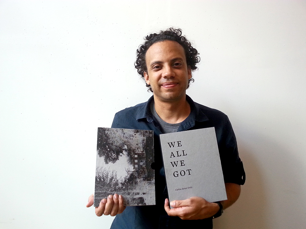 Carlos with book small.jpg