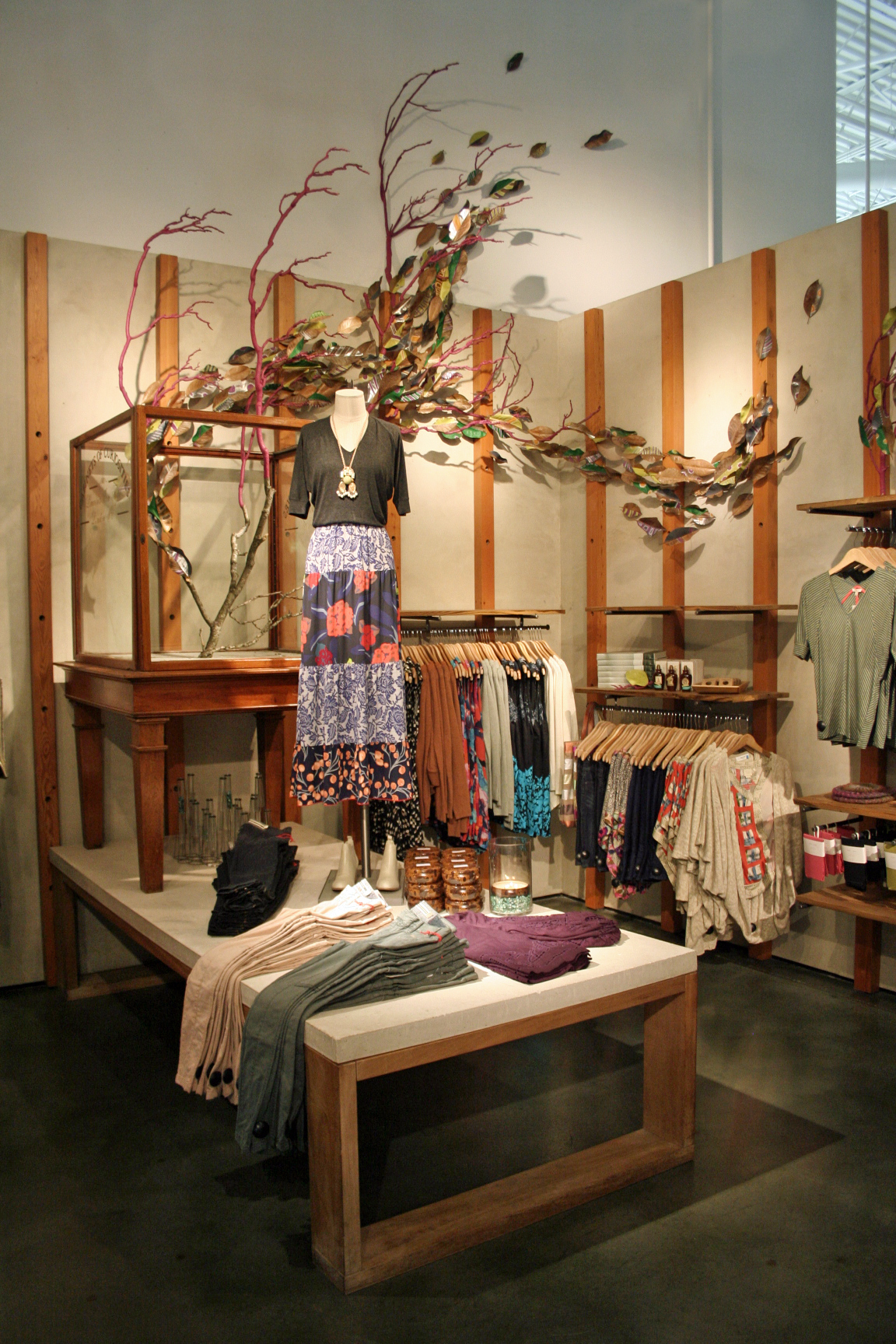 anthropologie display of painted leaves and found object