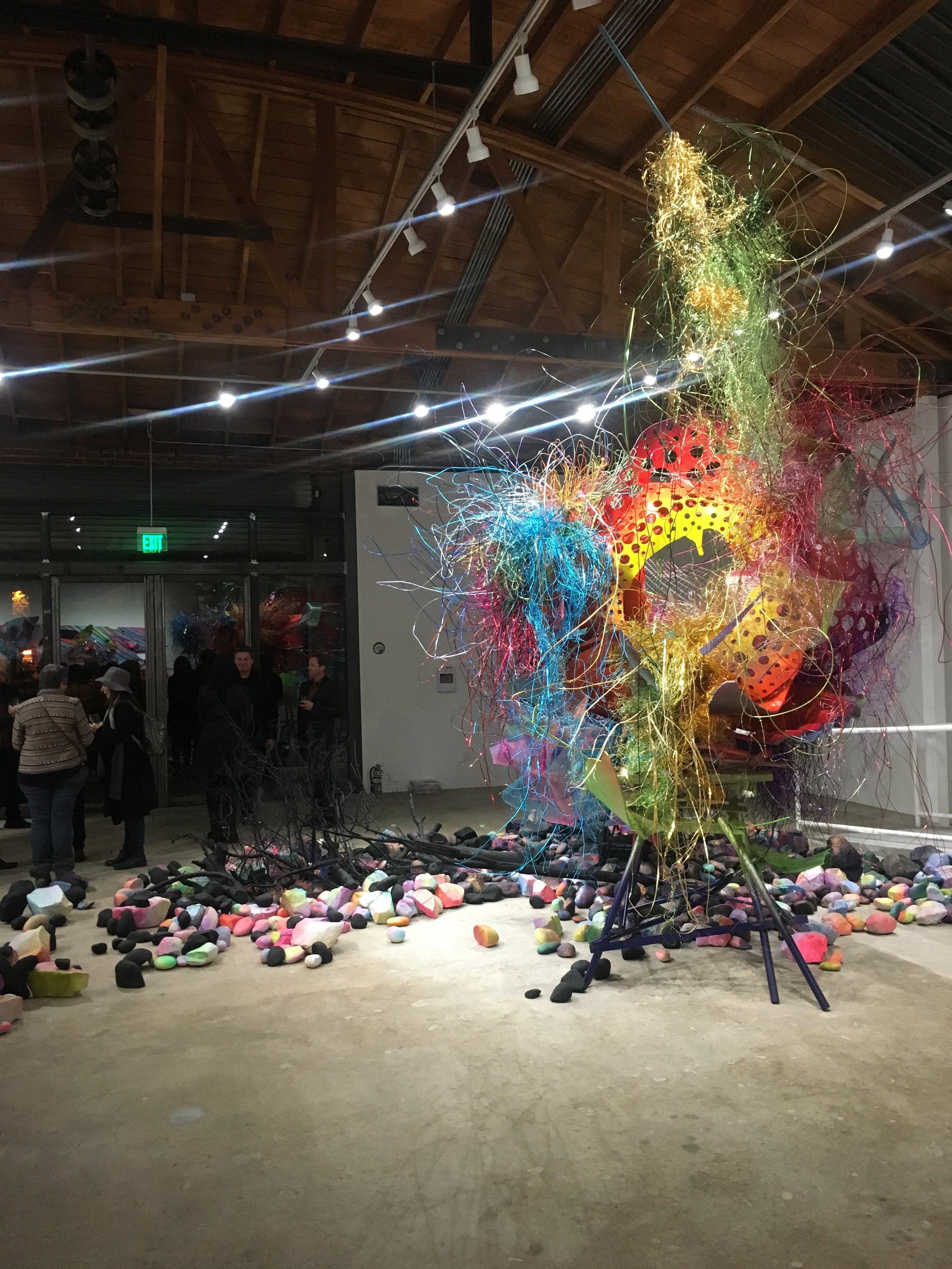 The installations were terrific, ornate messes of colorful materials.