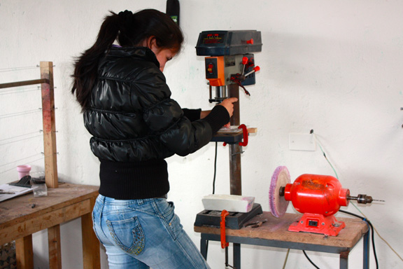 This young mother uses power tools to put the finishing touches on her masterpiece. Every item is designed with you in mind, ensuring the quality and longevity of every piece in our collection.