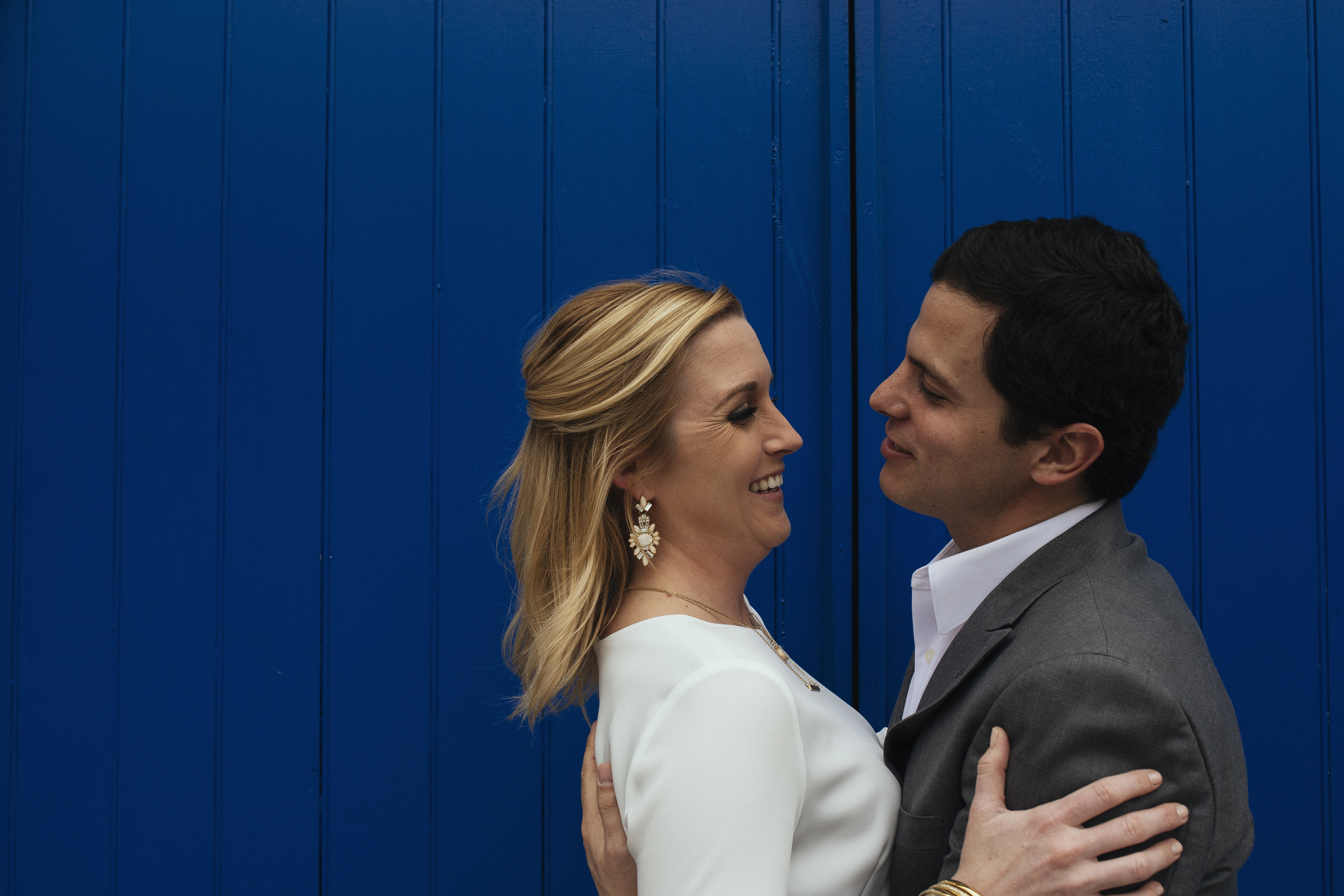couple against blue wall