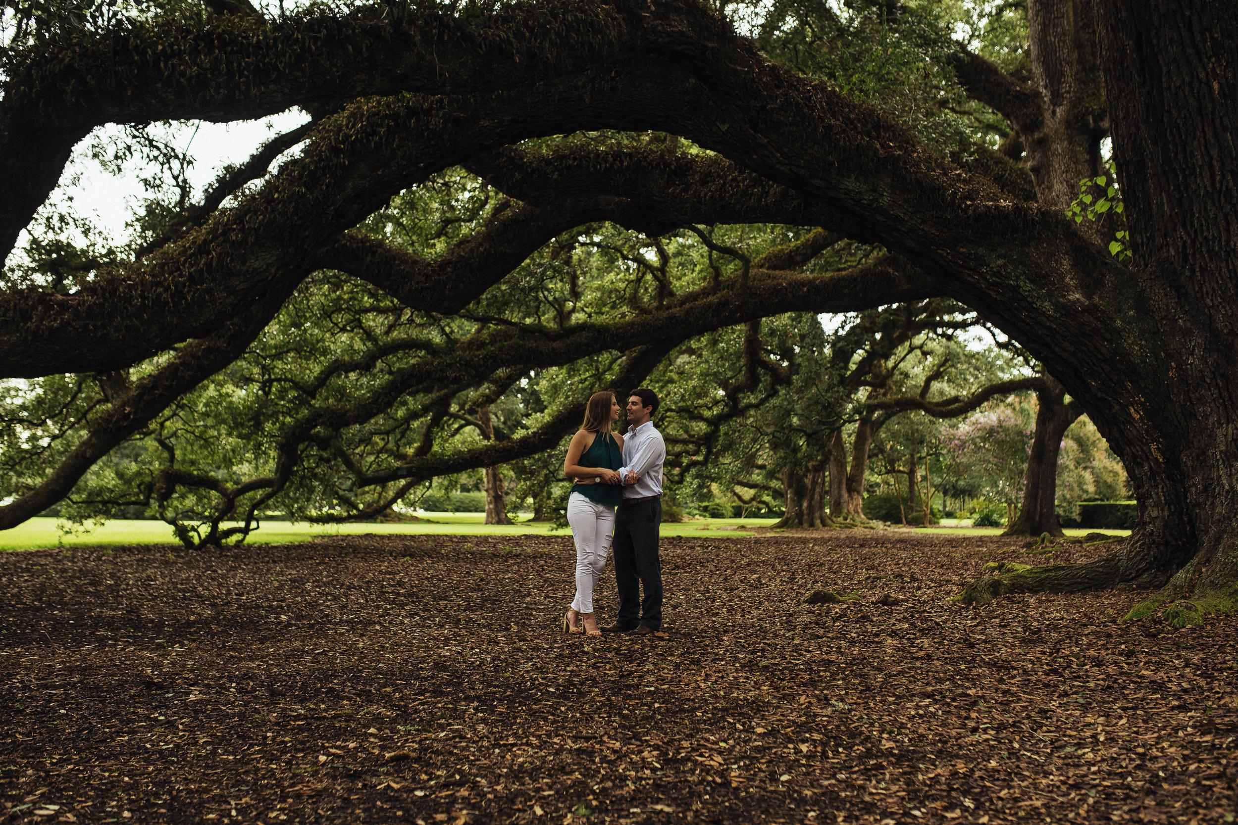 couple under the oak trees