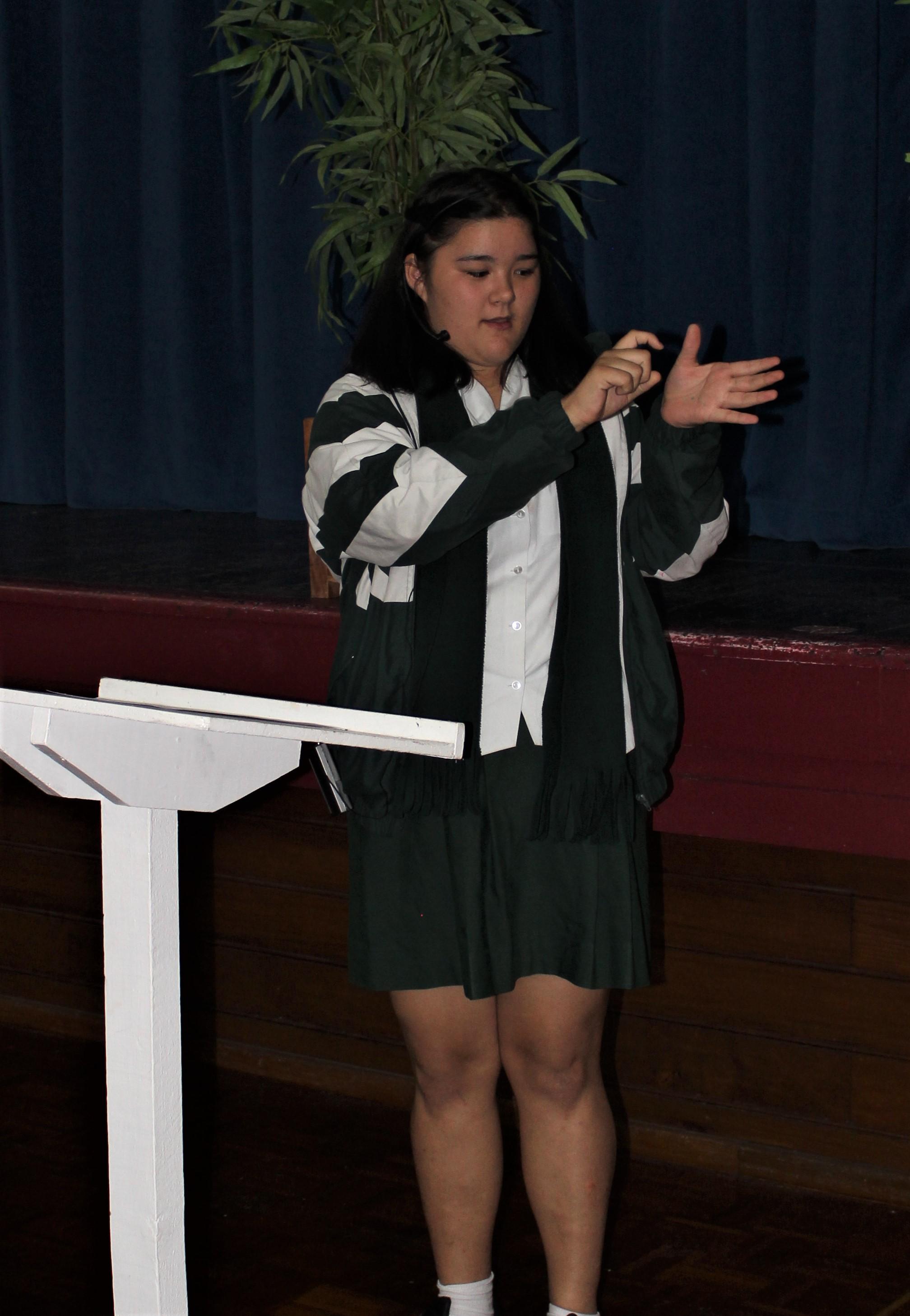 13 Contestant 7 Using Sign Language.JPG