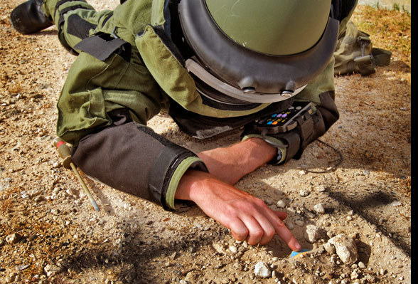 A Navy AUSCDT4 diver gently approaches an enemy IED