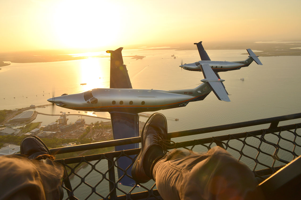 Self portrait of Jon's pov over Darwin Harbour at dawn, with two NT Police Air Wing PC12's