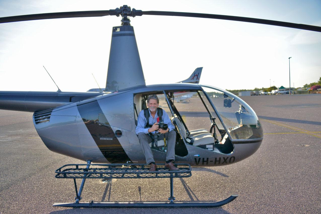 Jon in an R44 following a photo sortie over Darwin. Photo by David Adamson