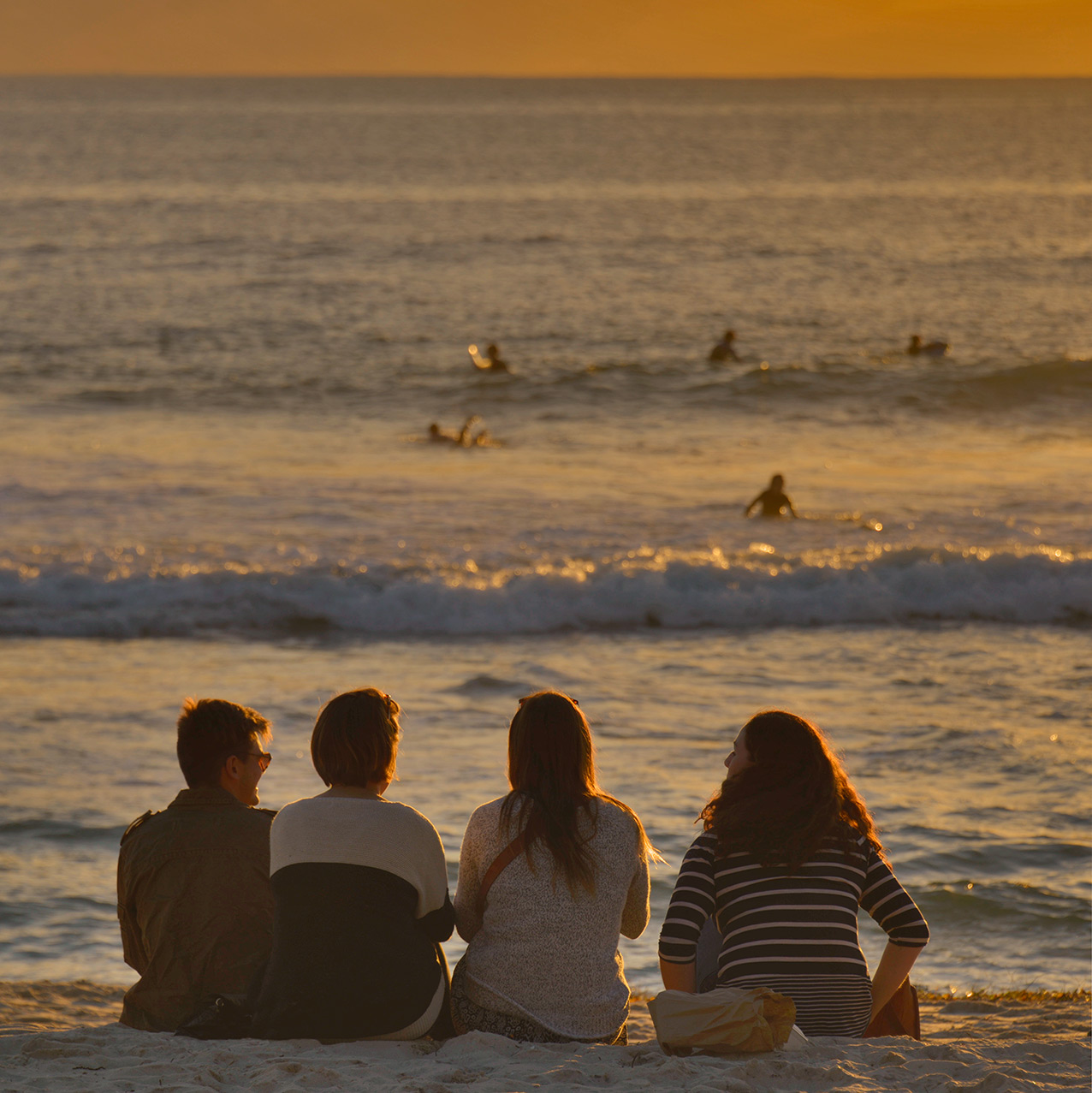 Surf watching at sunset