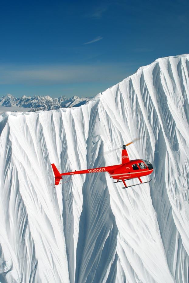 R44 helicopter over Chugach Mountains, Alaska