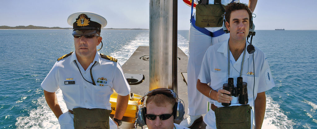 The Captain and his officers on the sail of HMAS Rankin, a Collins Class submarine, returning home from a RIMPAC exercise