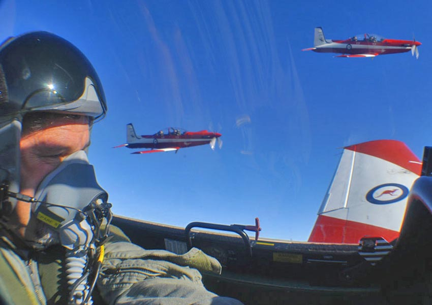 Self portrait with a formation of a Pilatus PC9
