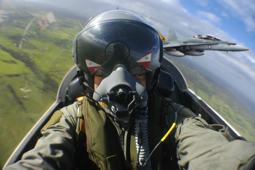 Self portrait in a Pilatus PC9 in formation with an RAAF F/A.18 Hornet